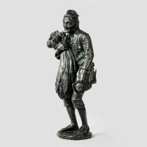 A bronze of a farmer holding a wheat sheaf, by Kenjiro. c1890