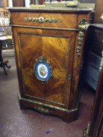 A cabinet by I & W Banting
