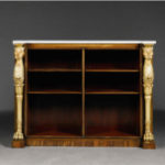 A pair of Regency rosewood and parcel gilt bookcases C1815