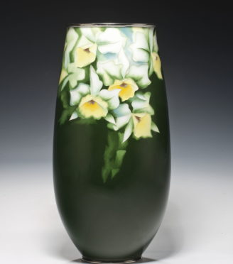 green vase with white flowers