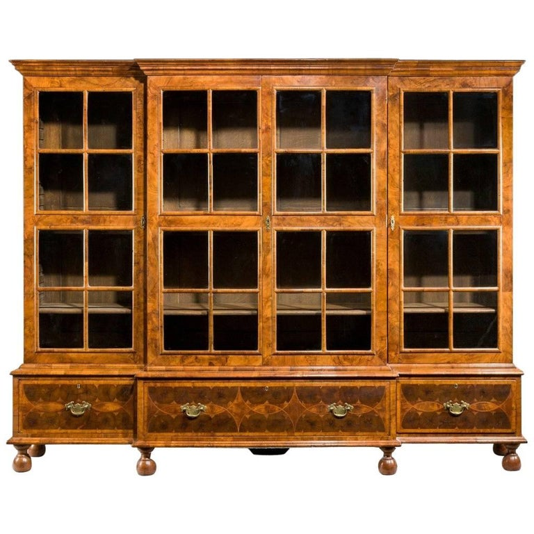 Peeps style breakfront four door bookcase of small proportions.