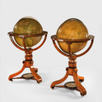 """A fine pair of Cary's 21"""" library globes, with oak and ebony stands."""