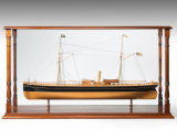 A fine shipyard model of a steamship with good detailed deck fittings, set in a mahogany case. Circa 1865