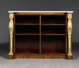 A pair of Regency rosewood and parcel gilt bookcases. Circa 1815