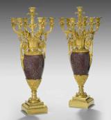 A pair of Empire royal porphyry and ormolu candelabra. Circa 1840