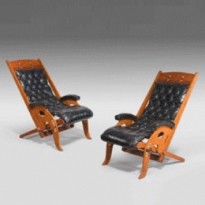 An unusual pair of adjustable Edwardian hard wood yacht's deck chairs with brass fittings. c1910