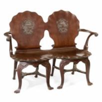 An Irish George III mahogany double chairback hall settee/ bench, c1790
