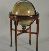 Rand McNally terrestrial globe set in an Art Deco Mahogany stand, c1920.