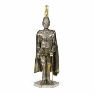 A set of polished steel and brass fire-irons in the form of a guardsman. c1900.