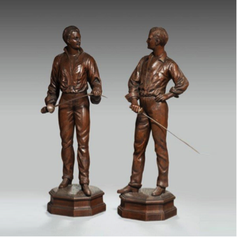An unusual pair of walnut carved fencers. Continental c1910.