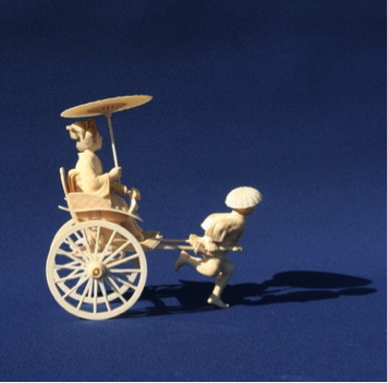 A Meiji period okimono of a bijin being pulled along in a rickshaw