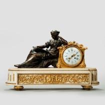 A Napoleon III gilt mantle clock by Deniere. c1865