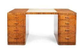 A George V Art Deco figured walnut kneehole desk. c1930