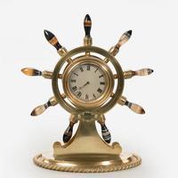 An agate and brass ship's wheel clock, Asser and Sherwin. Circa 1895. £895