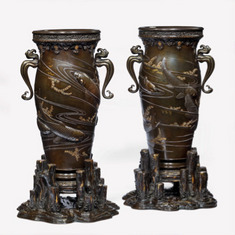 A pair of Meiji period bronze vases with carp, Japanese, c1880. Ht 19in
