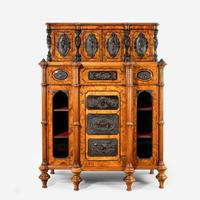 A burr walnut Cabinet by Lamb of Manchester. English. Circa 1870.