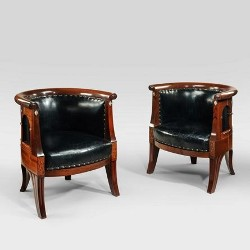 A pair of Anglo Indian hardwood bergère chairs with original double canework, c1900.