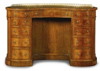 A Victorian walnut and feather banded kidney shaped kneehole desk, c1870