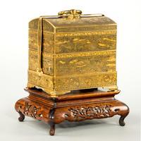 A gold inlaid iron miniature jubako by Komai of Kyoto, Meiji period, Japanese circa 1880