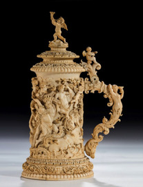 A German ivory tankard with an enthroned Goddess, late 19th C Ht 16in 17 ½ in