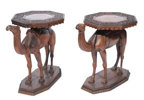 A pair of Anglo-Indian teak camel tables circa 1900
