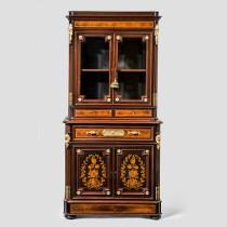 A Napoleon III kingwood bookcase of unusually small proportions. c1865