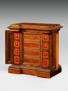 A Victorian walnut library cabinet - with leathered drawers, c 1845