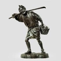 A fine Meiji period bronze of a fruit picker by Udagawa Kazuo. c1890