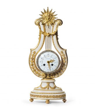 A late 19th century ormolu and white marble mantel clock by Cousard,