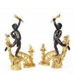 A pair of late 19th century ormolu and bronze chenets detail