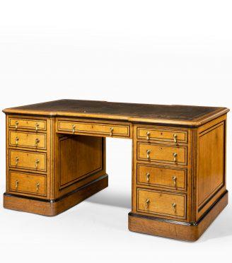 Small Victorian oak and ebony partner's desk