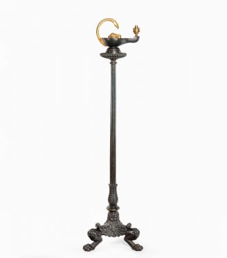 A cast iron colza style standard lamp