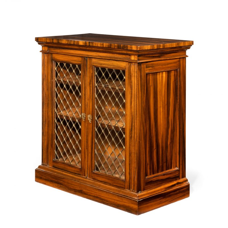 A late Regency Gonçalo Alves two-door side cabinet attributed to Gillows