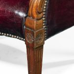 A pair of barrel-backed mahogany wing arm chairs detail