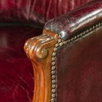 A pair of barrel-backed mahogany wing arm chairs close up