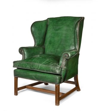 generous George III mahogany wing arm chair
