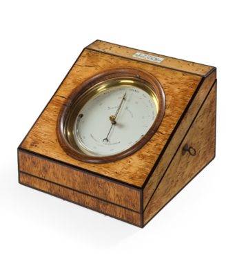 An aneroid desk barometer by C W Dixey,