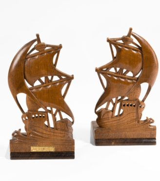 A pair of teak book ends from H MS Iron Duke