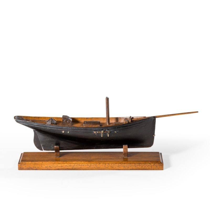 Victorian model of a racing yacht, with brass fittings, on a wooden stand original paint topsides English, c 1870.