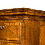 A George I walnut tallboy, of tall rectangular form,