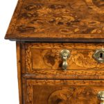 A William and Mary marquetry walnut veneered chest of drawers details