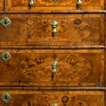 A William and Mary marquetry walnut veneered chest of drawers detail