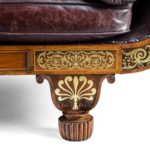 A George IV brass inlaid rosewood country house three-seater sofa attributed to Gillows leg