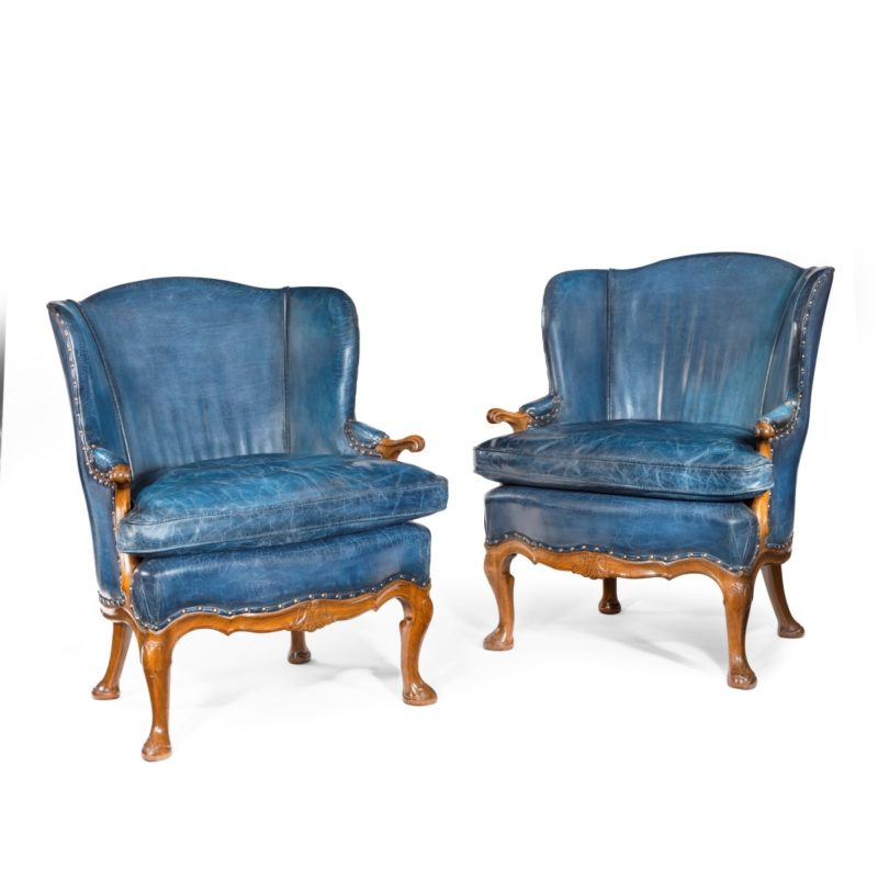 A pair of very generous mahogany wing armchairs attributed to Whytock and Reid, Edinburgh