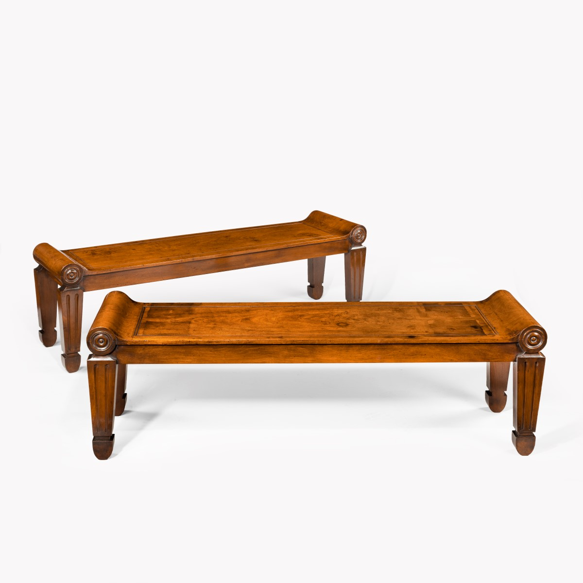 A pair of George III mahogany hall benches in the manner of Marsh & Tatham