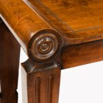 A pair of George III mahogany hall benches close up