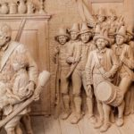 A large and superb quality walnut-framed Tyrolean lime-wood carving detail