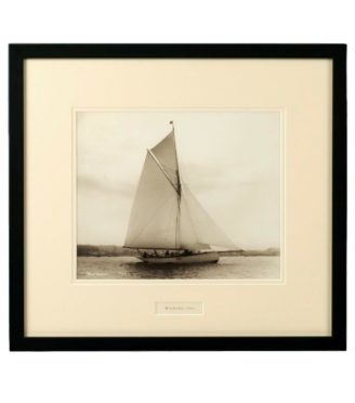 Early silver gelatin photograph print on the Gaff rigged yacht Wayward sailing on port tack with Cowes in the background by Beken of Cowes. Signed and Dated 1902.