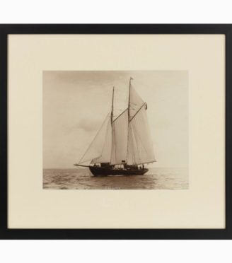 A rare early photographic print of the Schooner Cacouna tack in the Solent. She is flying the burgee of  the royal Thames yacht club  at the top of  her main mast. Signed in ink. Kirk Cowes.
