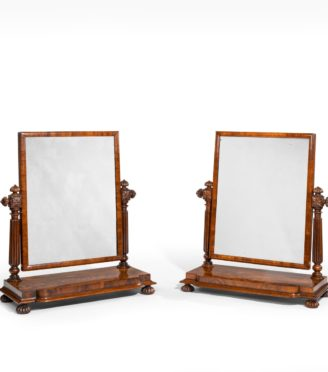 A pair of George IV mahogany table mirrors attributed to Gillows